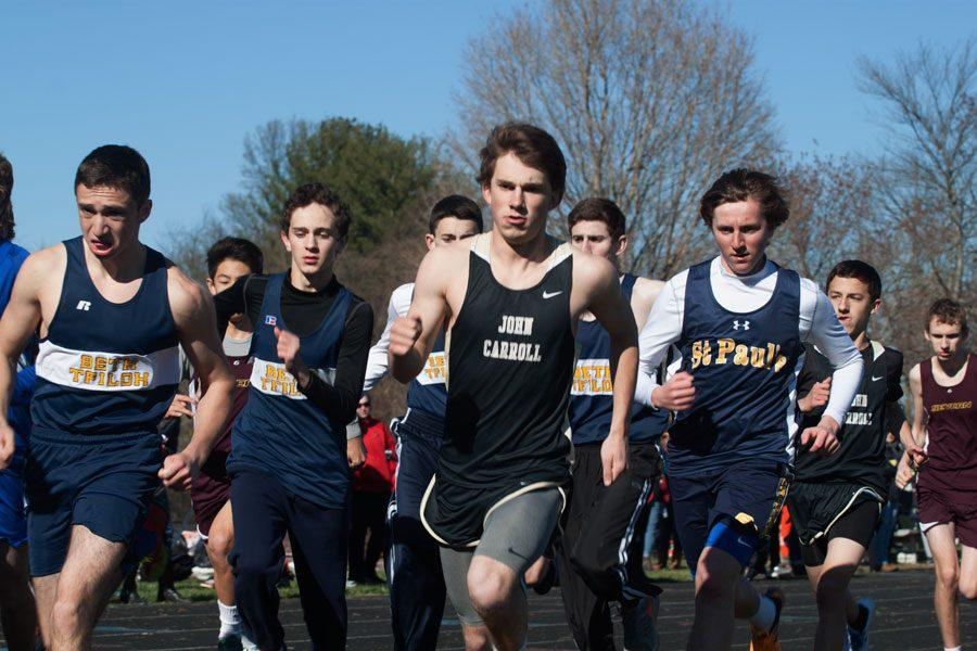 Heading the pack, senior long distance runner Evan Moore races against multiple high schools in the MIAA. The mens track team finished their season bringing home a championship for the first time in four years.