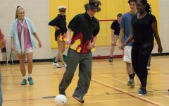 Senior Matt Becker kicks the ball while maneuvering through defense during a game of indoor soccer. All senior Field Day teams played games including soccer, frisbee and dodge ball against each other.