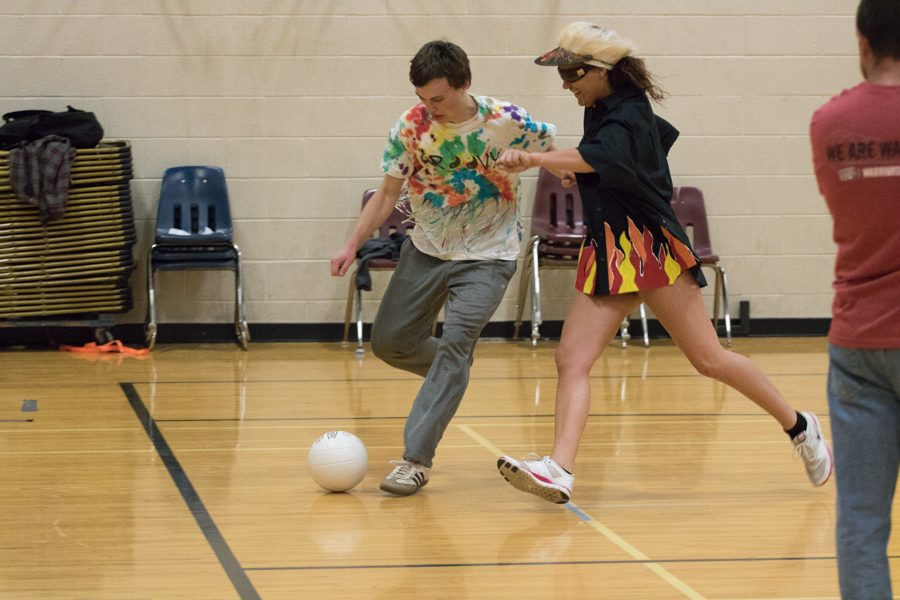 Seniors Scott Pajerowski and Brooke Vogel participate in a game of soccer in the lower gym during senior Field Day. Field Day took place on Friday, May 6 indoors due to bad weather.
