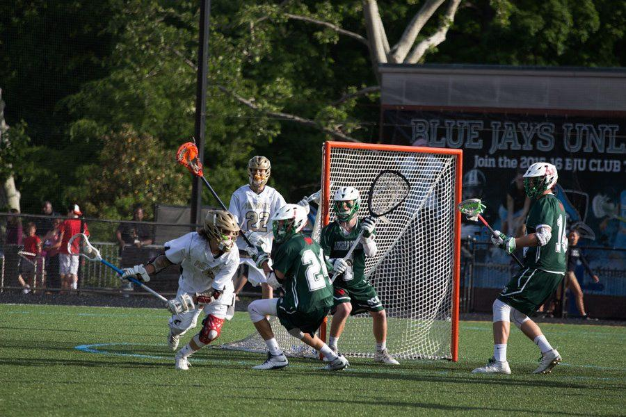 Sophomore Jude Brown dodges from behind the goal to get a look for a shot. The men's lacrosse team capped off a great season, winning the MIAA B conference championship 17-9 against Glenelg.