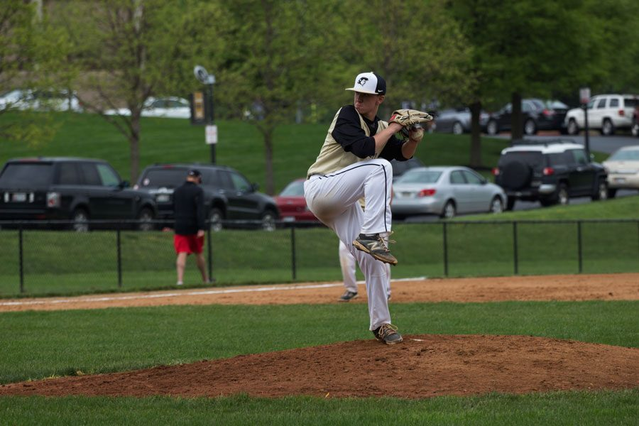 Junior pitcher Alex Marlow winds up for a pitch in the third inning. The Patriots were defeated by Dulaney High School 5-4 on May 9.