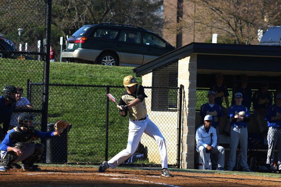 Senior Nick Turnbull swings at a pitch against Loyola Blakefield. The baseball team finished their season with a record of 9-15.