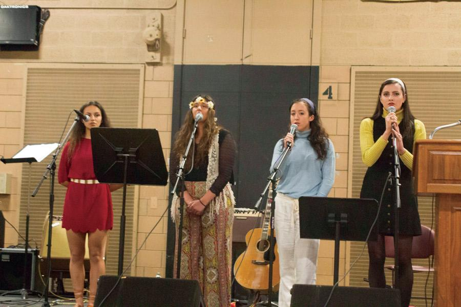 Seniors Faith Ensor, Nicolette Ficca, Hailey Schilling, and Lilly Stannard perform during the Peace and Justice Assembly on April 6. The Assembly featured singing and speeches from students and faculty about inclusivity, discrimination, and diversity.