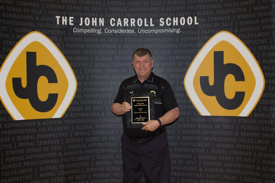 Earth Science teacher Tim Perry poses after receiving the Educator of the Year award. Students voted for Perry out of a list of six nominees.