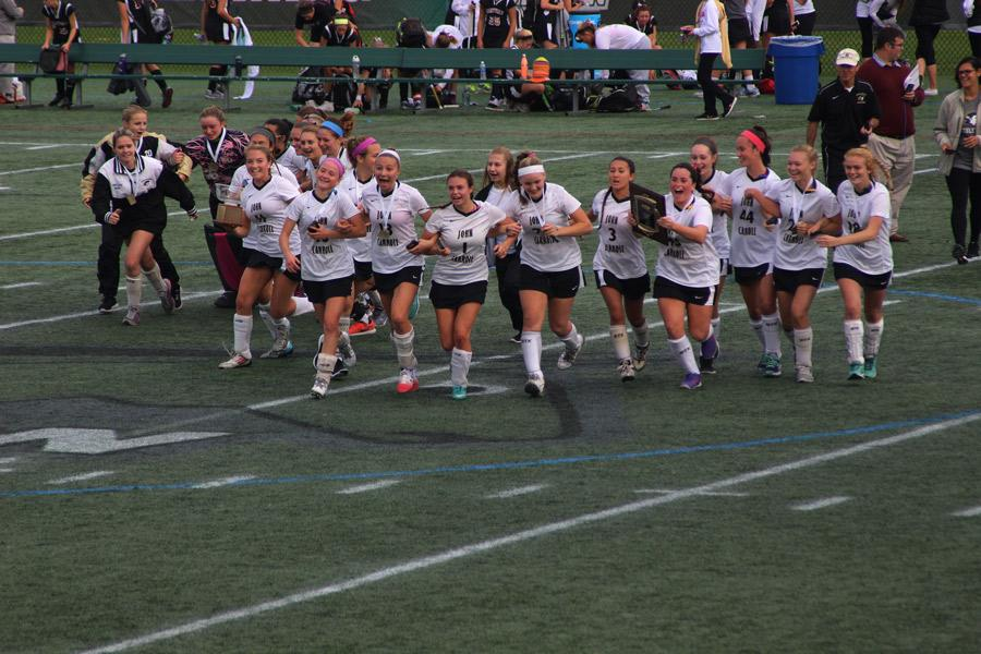 Alice Puckett takes over as head coach of the field hockey team seen here winning its second championship in a row. Puckett now feels pressure from herself to win again next season and three-peat as champions.