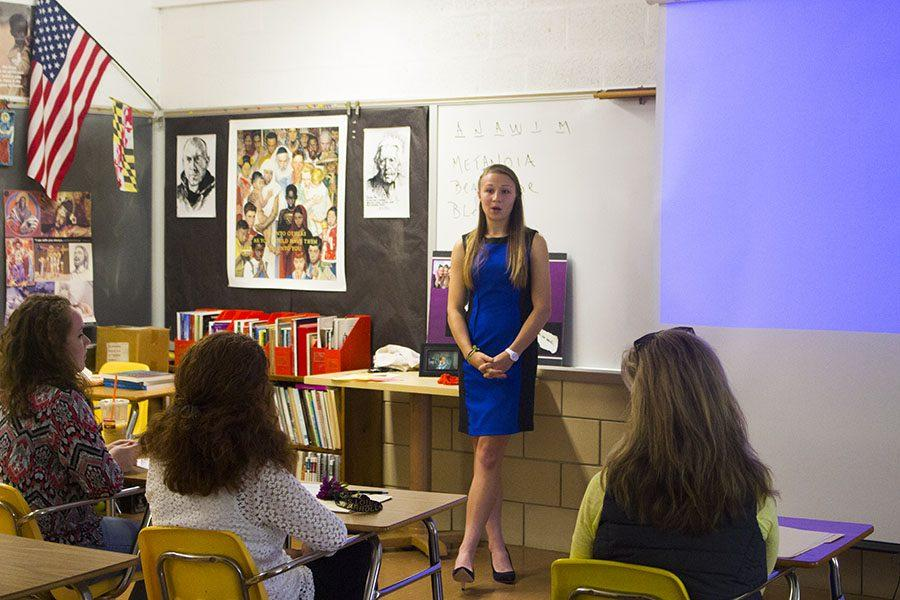 Senior Sam Carey answers questions while presenting her senior project on the importance of teaching young girls positive self-esteem. Each senior was required to create and present a senior project in front of a panel of three judges in order to pass senior year and graduate.