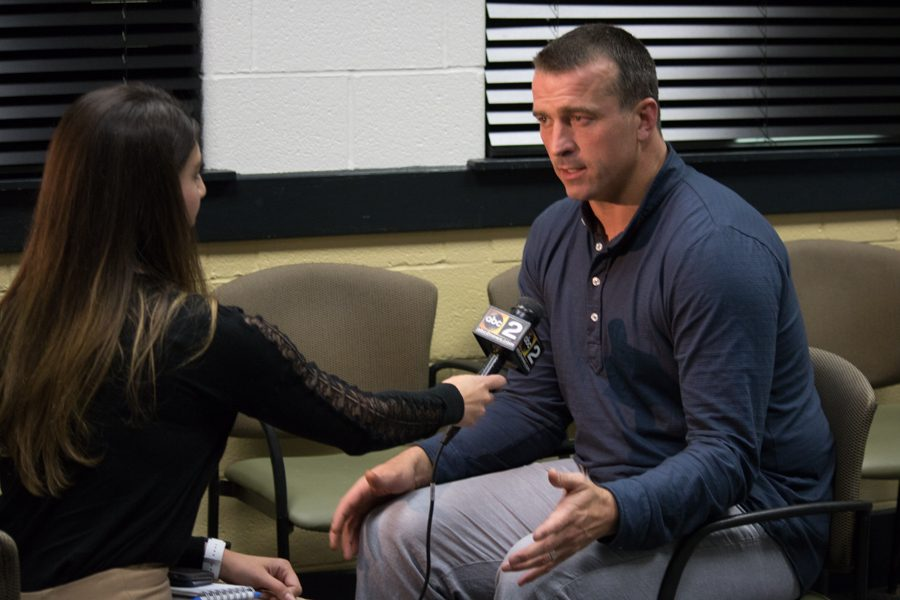 ABC2 News reporter Mallory Sofastaii interviews Chris Herren during a press conference. Herren came to speak at John Carroll about his recovery from addiction on May 18.