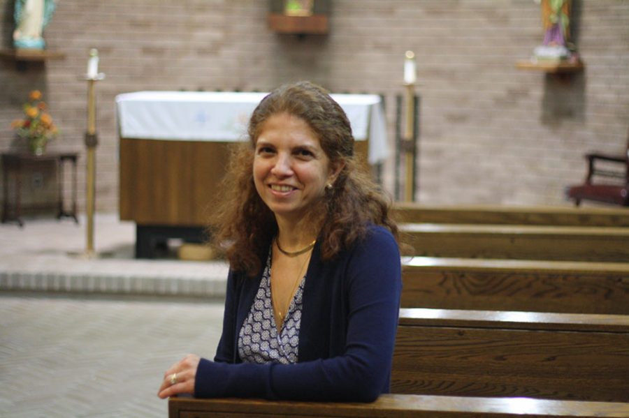 Campus Minister Michelle Sullivan sits in the chapel.