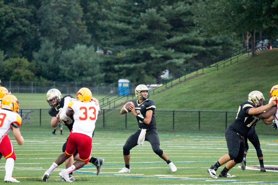 Junior quarterback Qadir Ismail winds up to throw to an open receiver against Calvert Hall on Sep. 9. Ismail transferred from Patterson Mill High School to JC this year.