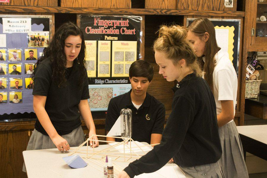 During the Science Olympiad meeting seniors Christina Giovanazi, Erica Deyesu, Ianna Pirozzi and freshman John DeSoto work on projects for various competitions. The Science Olympiad Club competes against multiple high schools in science-based events throughout the year. If you would like to join, please visit Dr. Andrew Ketchum in room 213.