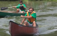 Seniors Nate Lebuhn and Chris Tassanari paddle across a lake during a canoe race. Four sets of boys and four sets of girls were chosen from each group of seniors and competed in two relay races against one another.