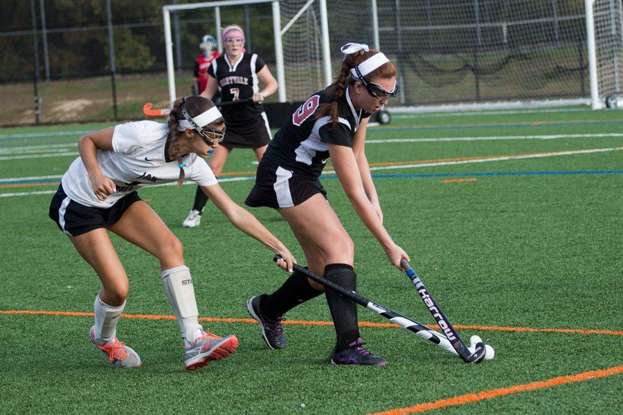 Junior right wing Kathryn Hodges reaches in an attempt to take control of the ball from a Maryvale player. The varsity field hockey team was defeated by Maryvale 0-1 in the rematch from last year's championship on Monday, Oct. 17.