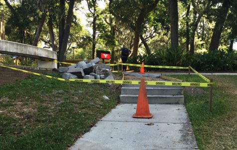 Caution tape blocks off one of the pathways on Jacksonville University's campus after it was damaged from Hurricane Matthew. Those affected by the storm have begun cleaning up the aftermath and repairing the damages.