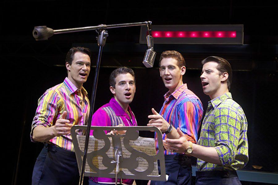 Nick Massi (Matt Bogart), Frankie Valli (Jarrod Spector), Bob Gaudio (Ryan Jesse), and Tommy Devito (Dominci Nolfi) all stand around a microphone in a recording studio singing one of their hit songs.