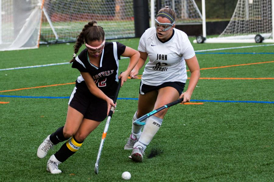 Senior left forward Maddie Reeves chases after a Maryvale player in an attempt to get the ball back. The varsity field hockey team lost to Maryvale 0-1 in the rematch of last year's championship on Monday, Oct. 17.