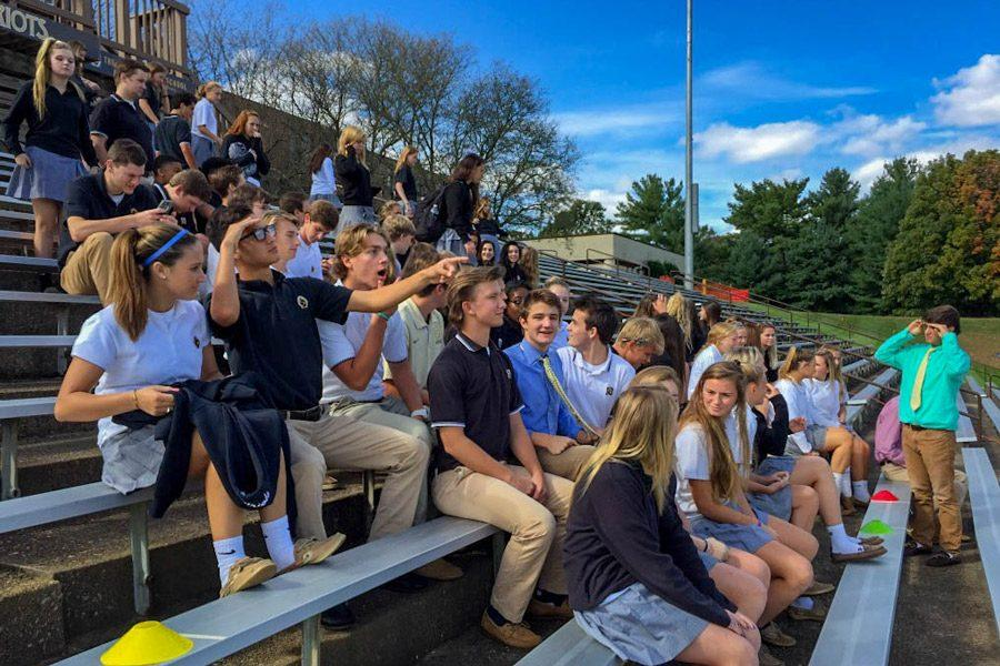 The class of 2017 gathers outside on the stadium bleachers to take their senior panoramic picture. Students are able to purchase regular prints for $16 or laminated prints for $21.