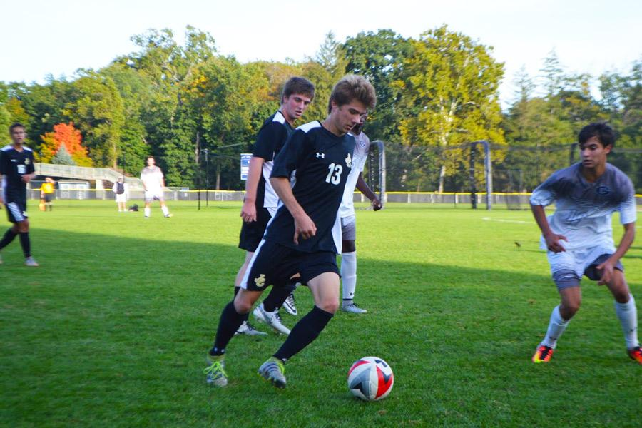 Senior midfielder Seth Anderson looks to play the ball down the sideline during a game against Gilman on Oct. 14. The varsity men's soccer team fell short 0-1, making their in-conference record 4-8.
