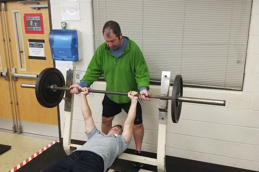 New wrestling head coach Mike Mazza spots senior Eric Ashton during an off-season workout. Mazza has been a wrestling coach for 17 years, four of which were spent as the head coach at Harford Technical High School.