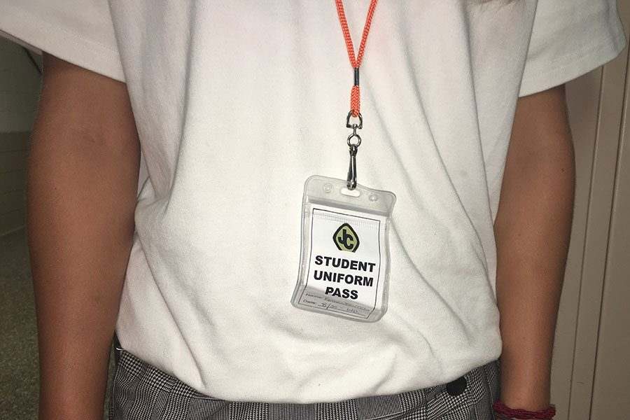 A newly-implemented disciplinary policy requires students out of uniform, for a variety of valid reasons, to go to the dean and get a student uniform pass like the one pictured above. The pass is worn around the neck of the student, and is meant to stick out.