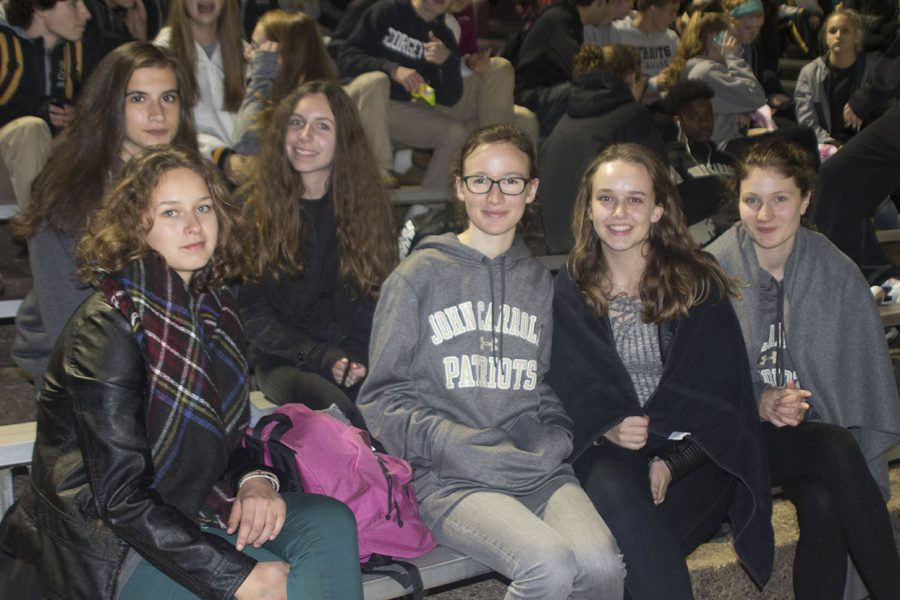 French exchange students pose for a photo while watching the football game against Palotti on Oct. 14. The exchange students will be in the U.S. for two weeks before returning to France on Oct. 21.