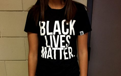During Spirit Week, junior Madison Daily wears a Black Lives Matter shirt for Nationality Day on Oct. 4. Daily and other African American students dressed down in all black to show their support for the Black Lives Matter movement instead of dressing in accordance with the official Nationality dress code guidelines.
