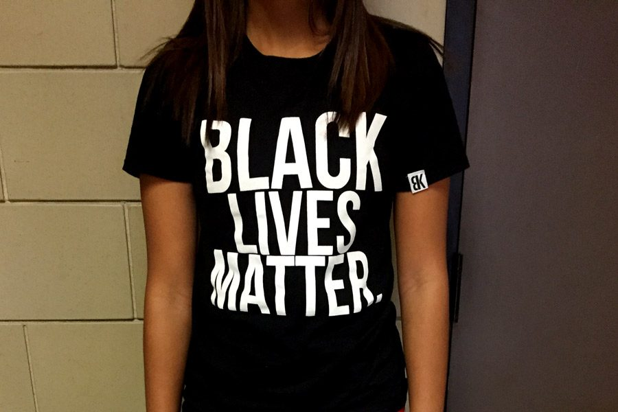 During+Spirit+Week%2C+junior+Madison+Daily+wears+a+Black+Lives+Matter+shirt+for+Nationality+Day+on+Oct.+4.+Daily+and+other+African+American+students+dressed+down+in+all+black+to+show+their+support+for+the+Black+Lives+Matter+movement+instead+of+dressing+in+accordance+with+the+official+Nationality+dress+code+guidelines.