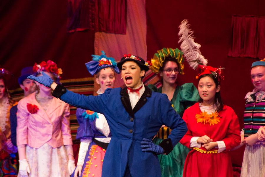 Junior Ella Wilson portrays the character Mary Poppins while singing the song