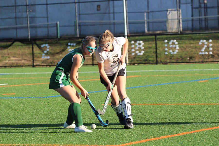 Freshman right back Kate Gromacki dodges a defender from Indian Creek on Oct. 25. Gromacki was a starter on the varsity field hockey team this year and was a part of the championship run this season.