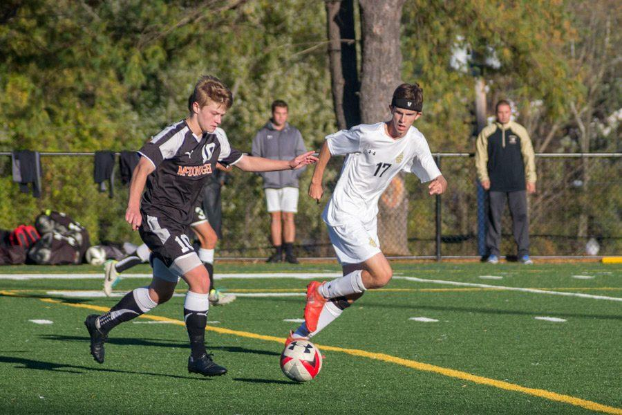 Senior midfielder Andrew Kappel chases down an opponent looking to play the ball to the corner during a game against McDonogh on Oct. 28. Kappel has been on varsity soccer for four years.