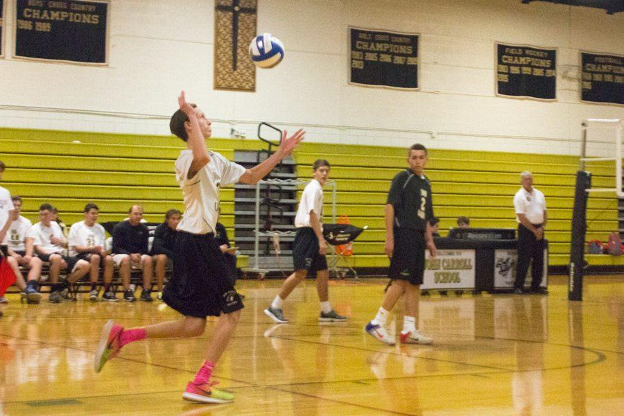 Senior outside hitter Franklen Lockhart serves the ball against Calvert Hall on Oct. 28. The men's volleyball team finished their season with an overall record of 2-16.