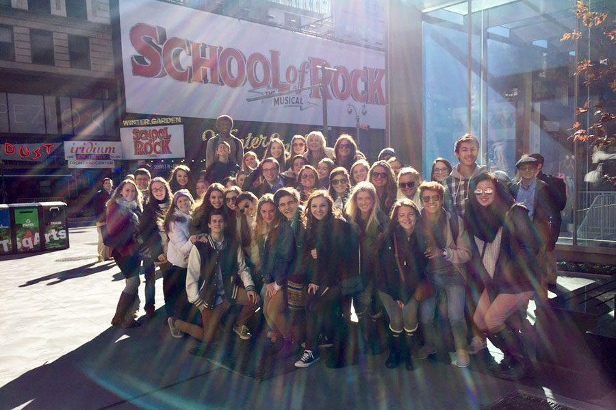 A group of students gather outside of The Winter Garden Theatre in New York where they went to see the musical