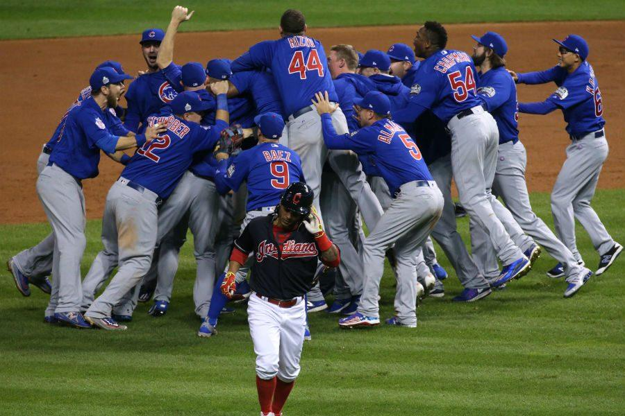 The Chicago Cubs celebrate winning the World Series at the end of Game 7 of the World Series between the Chicago Cubs and Cleveland Indians Thursday, Nov. 3, 2016, at Progressive Field in Cleveland, Ohio. (John J. Kim/Chicago Tribune/TNS)