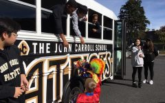 Senior Anthony distributes candy to trunk-or-treaters through the window of the JC school buses. Mountain Christian Church held it's annual trunk-or-treat in the teachers parking lot on Saturday, Oct. 29.