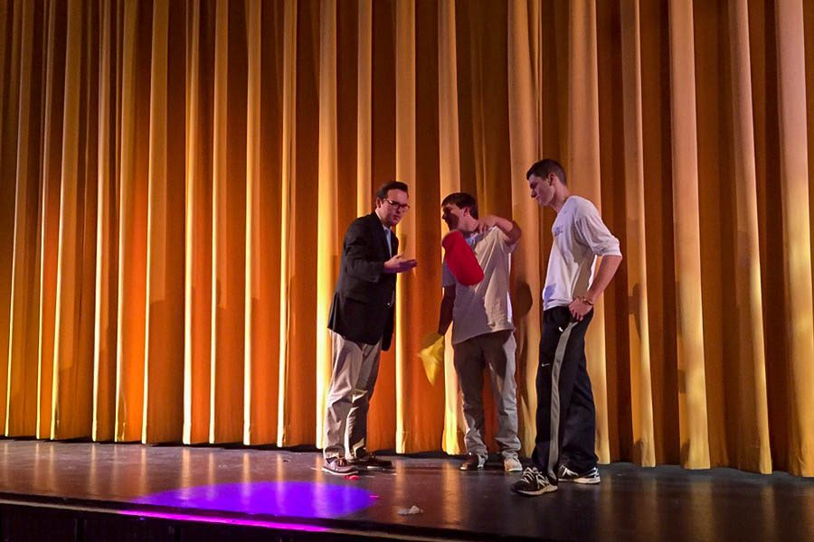 Seniors Zachary Miller, Steven Kutcher, and Arri Stakias (from left to right) demonstrate a magic trick during a Senior Variety Show rehearsal. Showtimes for the Variety Show include Nov. 22 and Nov. 23 from 7-9 p.m.