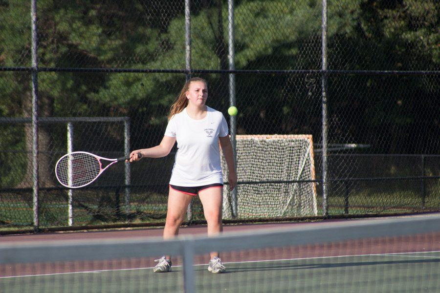 Sophomore Annie Iorio prepares to hit the ball during her singles match against Oldfields on Sept. 15. The varsity women's tennis team finished their season with a record of 1-8.