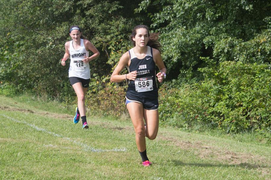 Junior Laura Amhrein passes an opponent on her way to the finish line at the Mustang Invite on Sept. 2. The women's cross country team finished with a 2-5 record in-conference this year.