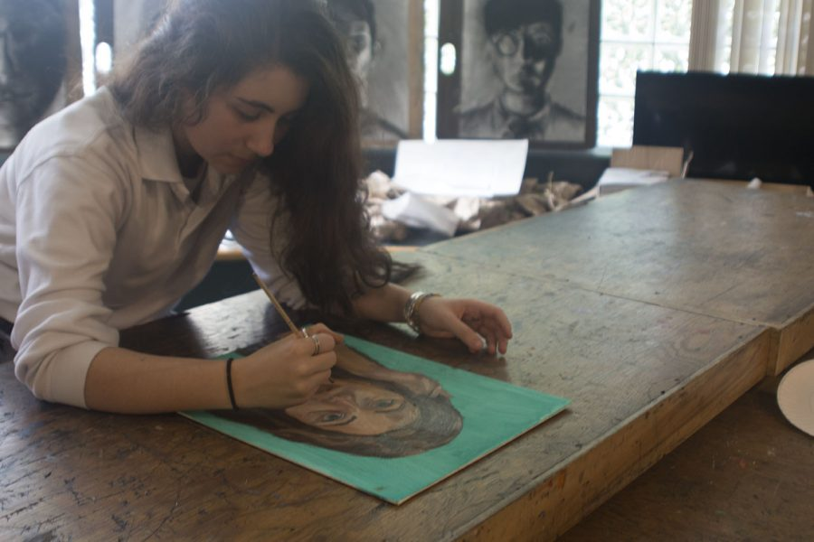 Junior Nicole Kanaras works on her latest self-portrait. Kanaras has been creating art since she was a child and plans to take AP Studio her senior year.