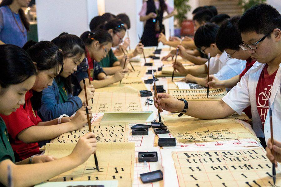 Students at the John Carroll School of Chongqing practice writing in Chinese during class. The school was established earlier this year and offers Chinese students a dual-program that combines American and traditional Chinese curricula.