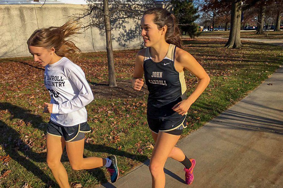 Senior Adria Pirozzi and junior Laura Amrhein warm up before their 800 meter relay. The women's indoor track team tied for third out of 15 teams in an IAAM group meet at CCBC Essex on Dec. 3.