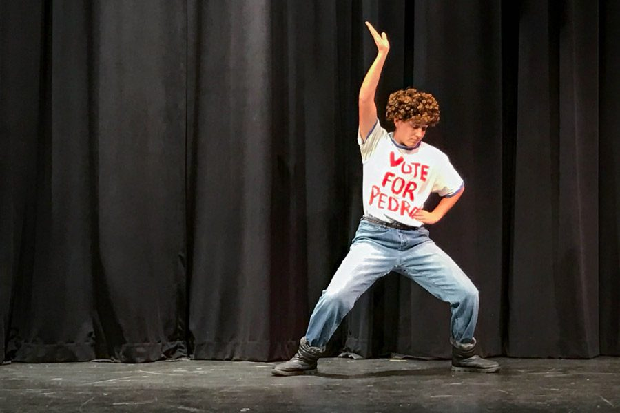 Senior Caroline Barwick mimics the moves to the famous Napoleon Dynamite dance during Variety Show rehearsal on Saturday, Nov. 19. The seniors raised over $8,200 towards their class budget.