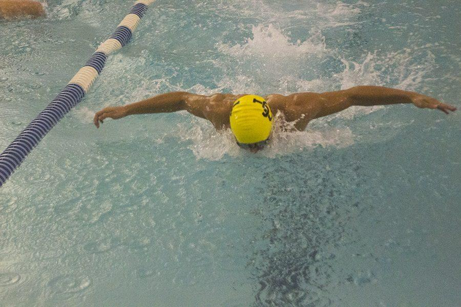 Junior Luke Ensor is close to his opponents as he approaches the final turn of the men's 100m butterfly. On Wednesday, Nov. 30, the men's swimming team competed against Beth Tfiloh Community School, losing the meet 59-91.