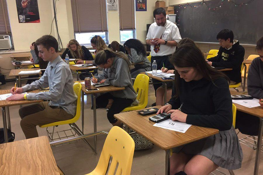 Senior Elizabeth Butz participates in the Math League competition on Dec. 13. The results from the first two competitions have put JC in an early lead to win the contest for the third consecutive year.