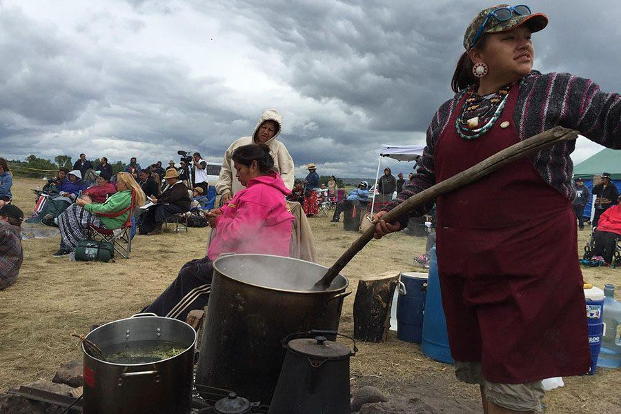 Nantinki Young - known as Tink - stirs large pot of soup for protesters gathered along the banks of the Cannonball River in North Dakota. (William Yardley/Los Angeles Times/TNS)