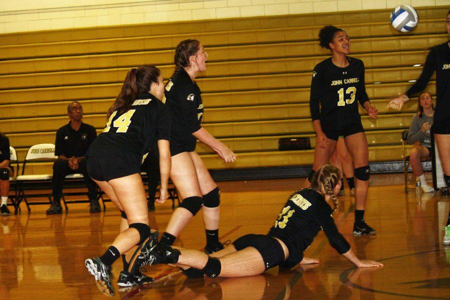 Senior Julianna Richard recovers after diving for the ball in the senior game against Mount de Sales Academy on Oct. 21. The team finished the season with an overall record of 6-13.