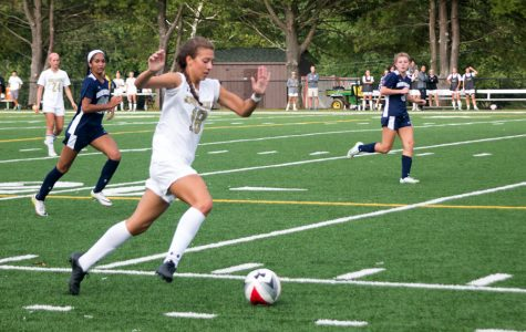 Racing down the field on a fast break, junior striker Marisa DiFonso drives towards the goal against Notre Dame Preparatory School on Oct. 4. The varsity women's soccer team finished 3-11 overall, but made it to the semifinals during playoffs, losing to Archbishop Spalding, 2-0 on Nov. 3.