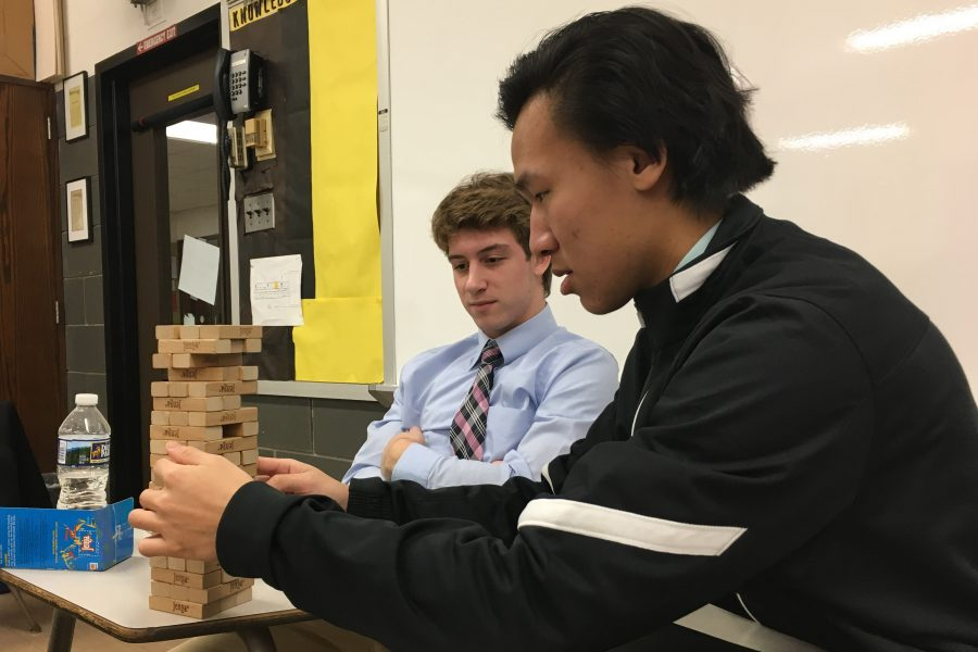 Seniors Mike McCabe and Dan Zheng (left to right) play the popular game Jenga on Friday, Jan. 20. Students in AP Psychology played board games in order to test their cognitive skills.
