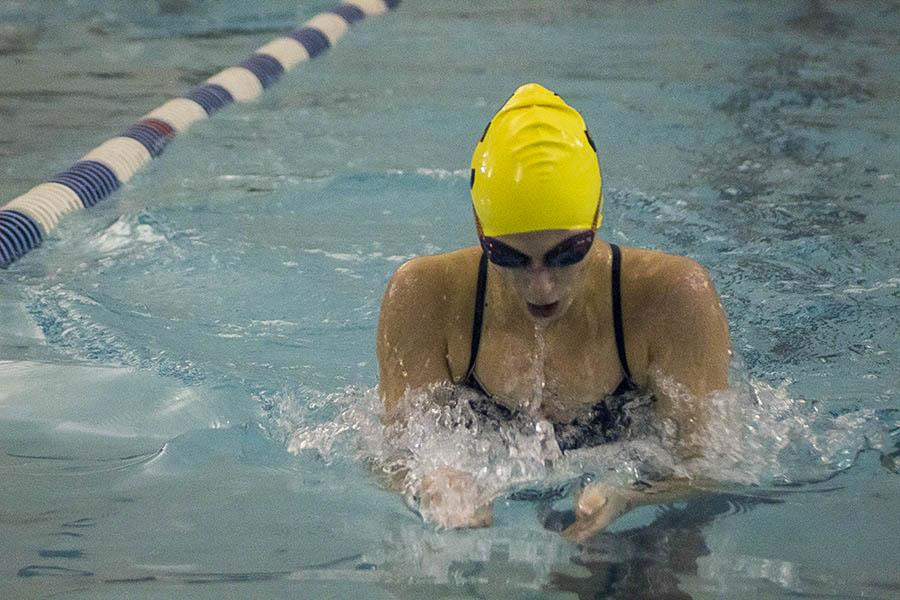 Junior Amelia Wickham leads the women's 200m Individual Medley as she approaches the wall during the breaststroke leg of the race. Wickham finished in first place in the 200m IM and second place in the 100m breaststroke.