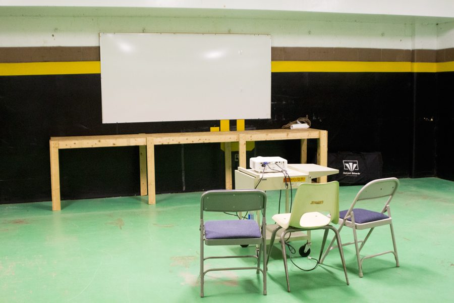 Chairs and a projector are set up in the new film room, which was converted from a storage room. Several athletic teams have used the new film room to watch highlights from previous games.