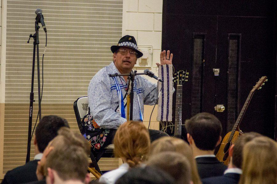 Spirit Wing singer Barry Lee explains a piece of Native American history to students during the Powwow assembly on Thursday, Jan 5. The Powwow assembly, held this Thursday, gave students a glimpse of the annual Morning Star Powwow which will be held at JC on Jan. 14.