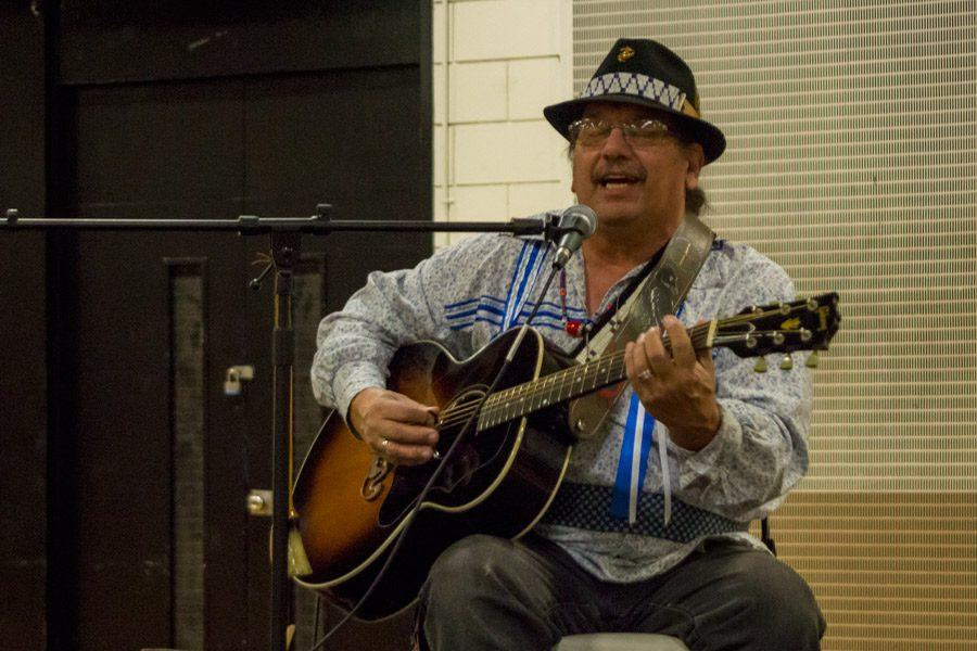 Berry Lee, member of the musical group Spirit Wing, performs traditional Native American songs for students during the H day assembly to promote the upcoming Morning Star Powwow. The powwow will take place on Jan. 14 from 10 a.m. to 8 p.m. in the upper gym at JC.